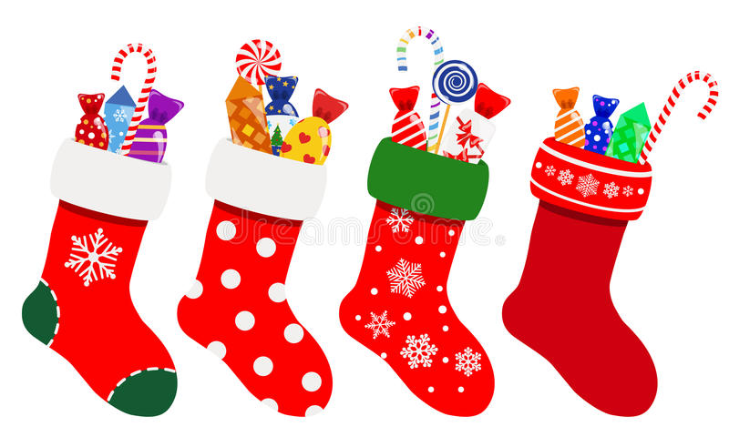 Christmas socks with candies. Set of Christmas socks in red colors with candies stock illustration