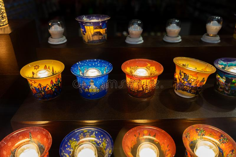 Christmas souvenirs - painted candle holders for sale at tradition Christmas market in Krakow. Poland. KRAKOW, POLAND - DECEMBER 10, 2019: Christmas souvenirs stock photos