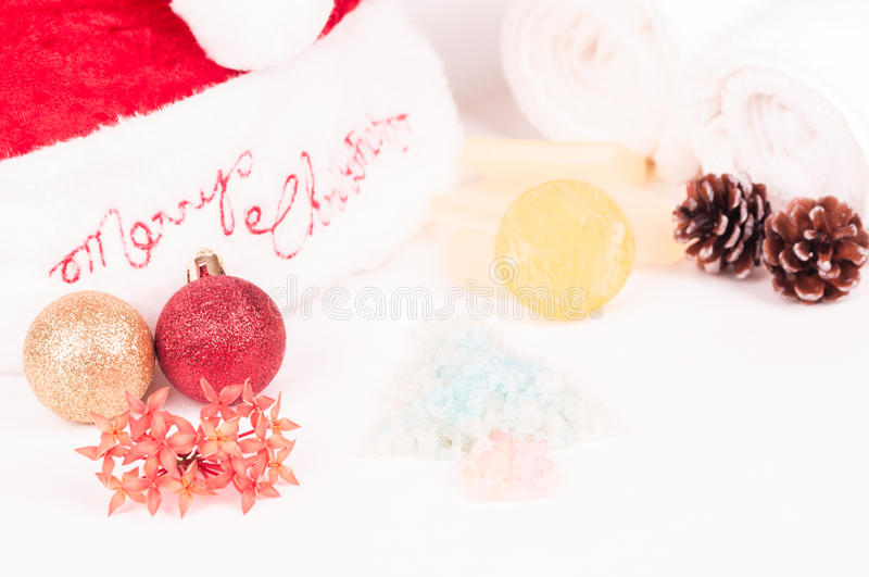 Christmas spa getaway. With baubles, bath salts and soaps close-up royalty free stock images