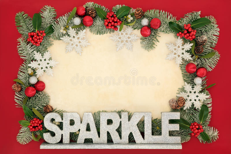 Christmas Sparkle Background Border. Christmas abstract background border with silver sparkle sign, glitter snowflake and bauble decorations, holly, mistletoe royalty free stock photos