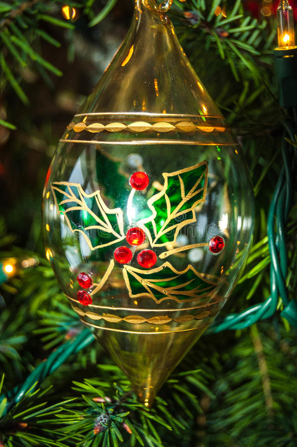 Christmas Sparkle. Glass Ornament hanging on a Christmas tree royalty free stock photos
