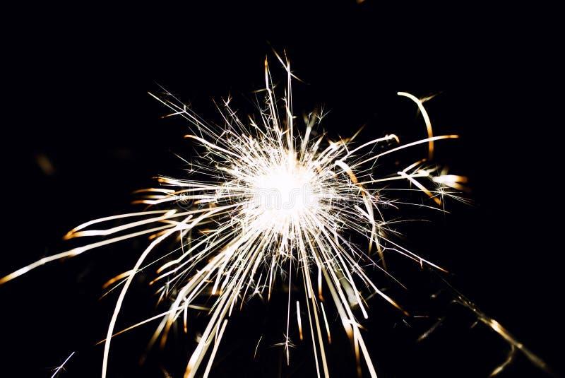 Christmas sparkler. Abstract, background, bengal, black, bright, burn, celebration, closeup, decoration, dust, energy, explosion, festive, fire, firework stock photos