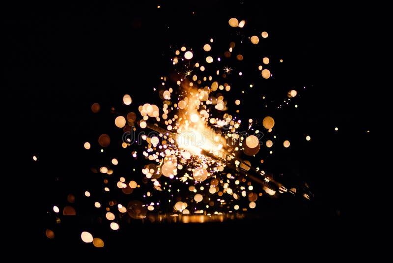 Christmas sparkler. Abstract, background, bengal, black, bright, burn, celebration, closeup, decoration, dust, energy, explosion, festive, fire, firework royalty free stock photo