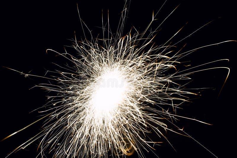 Christmas sparkler. Abstract, background, bengal, black, bright, burn, celebration, closeup, decoration, dust, energy, explosion, festive, fire, firework stock images