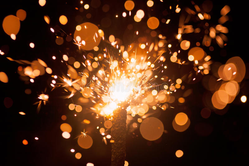 Christmas sparkler. With multitude of sparks royalty free stock images