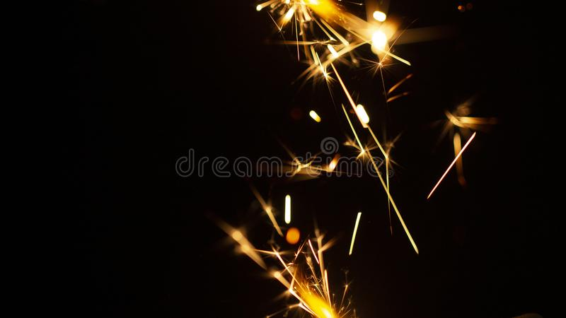 Christmas sparkler isolated on black background. Bengal fire. Close up stock image