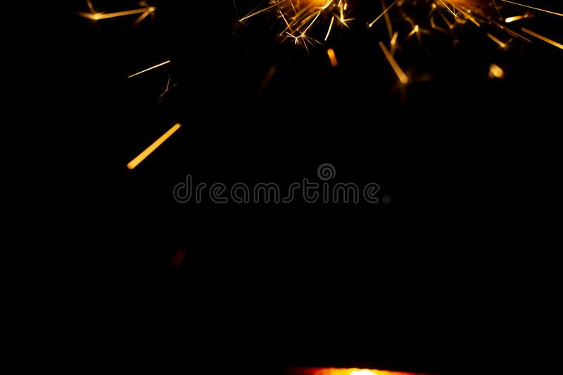 Christmas sparkler isolated on black background. Bengal fire. Close up royalty free stock photos