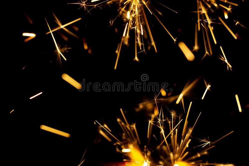 Christmas sparkler isolated on black background. Bengal fire. Close up stock photo