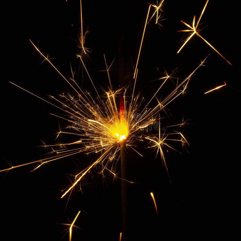 Christmas sparkler isolated on black background. Bengal fire. Close up stock photography
