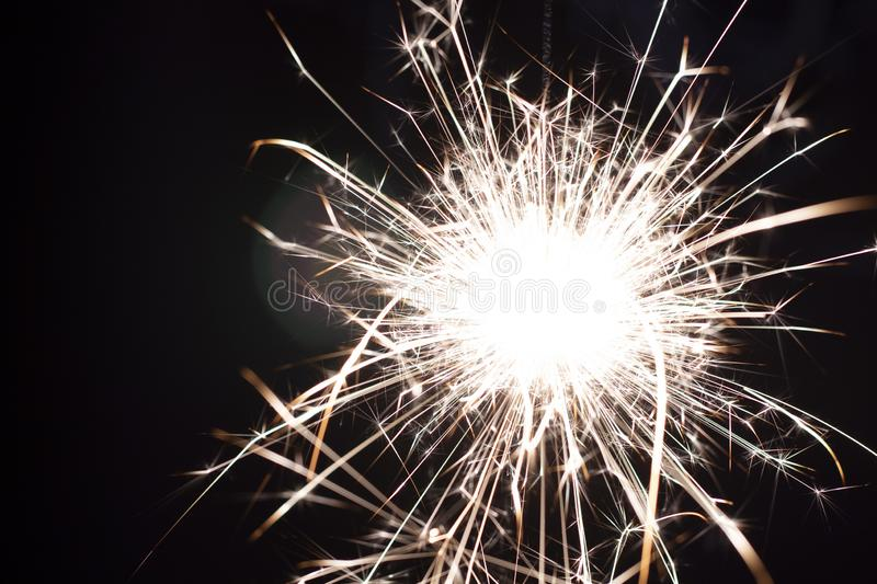 Christmas sparkler isolated on black background. Bengal fire. Close up stock images