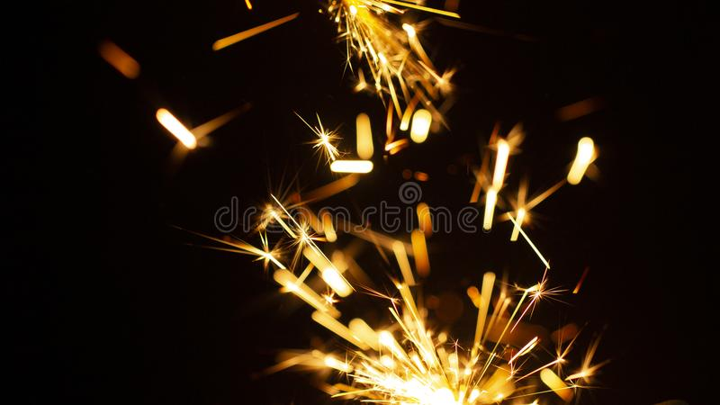Christmas sparkler isolated on black background. Bengal fire. Close up royalty free stock photo