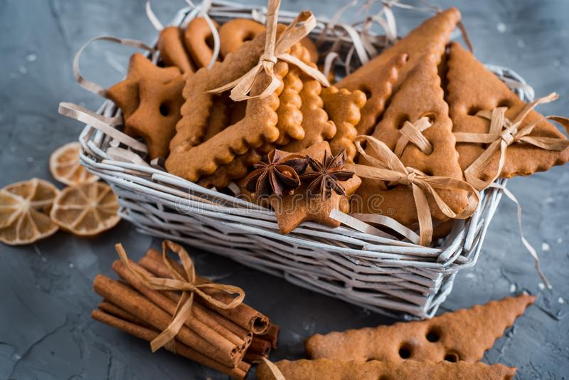 Christmas spices, gingerbread cookies and baking ingredients on grey concrete background. Cinnamon, anise stars, nutmeg, cardamon, stock images
