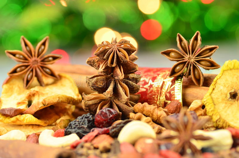 Christmas spices, nuts and dried fruits. Against bokeh background stock images