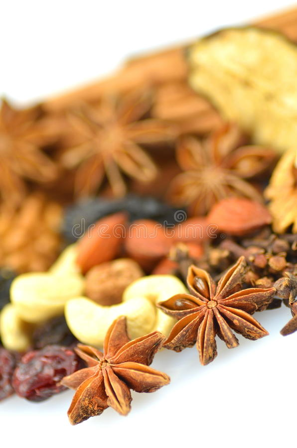 Christmas spices, nuts and dried fruits. Isolated on white background royalty free stock photos