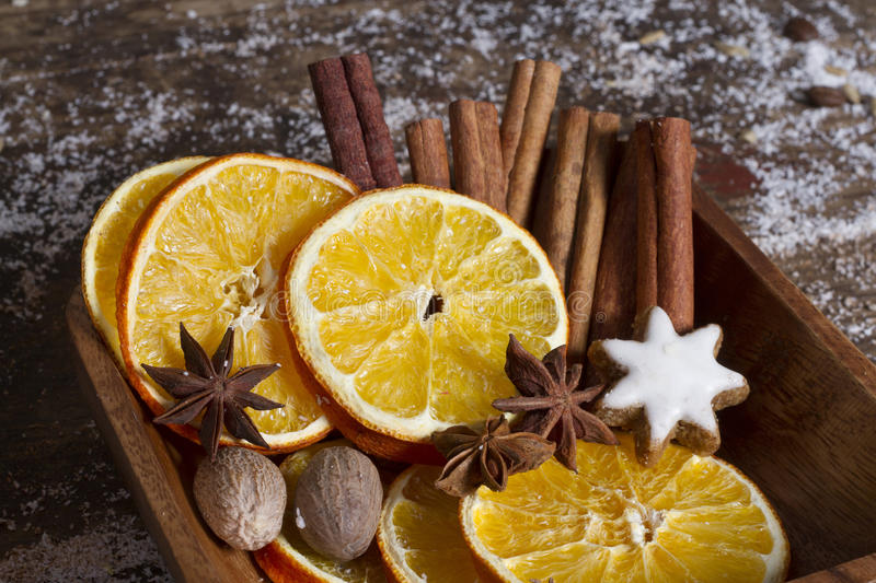 Christmas spices, nuts, dried oranges stock photo