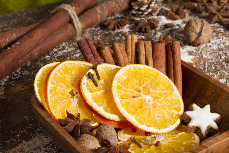 Christmas spices, nuts, dried oranges royalty free stock images