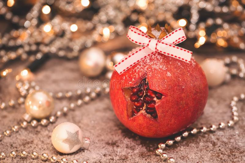Christmas spirit. A star cut out in a pomegranate stock photos