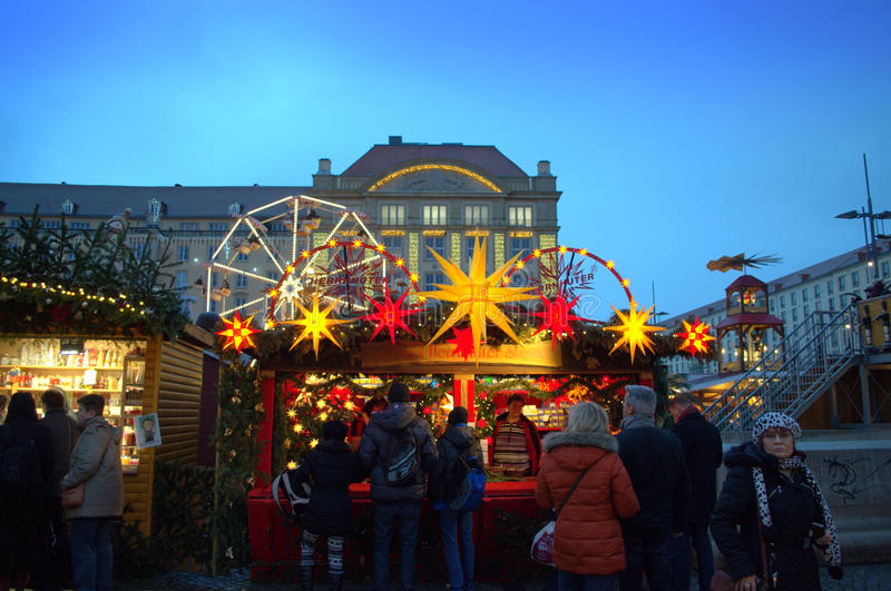 Christmas spirit Dresden. Picturesque decorated shops and people shopping at Dresden Christmas market , Germany stock photography