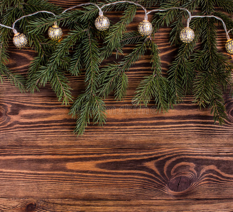 Download Christmas Square Composition With Vintage Garland And Fir Branches On Wooden Background String Lights