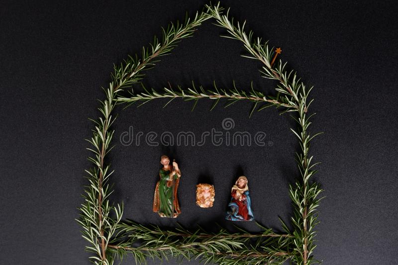 Christmas stable with figurer jesus, mary and joseph. Christmas stable of herb rosemary and figures jesus, mary and joseph stock photography