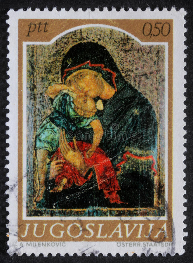 Christmas stamp printed in Yugoslavia shows Madonna and Child. A greeting Christmas stamp printed in Yugoslavia shows Madonna and Child, circa 1985 stock photos