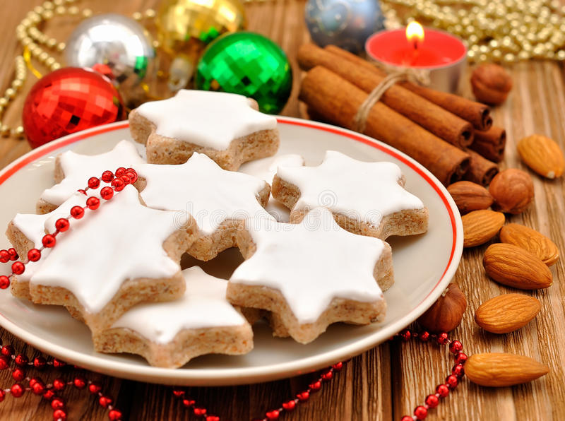 Christmas star cookies. Christmas cookies with nuts and cinnamon on a brown table with Christmas decorations stock photo