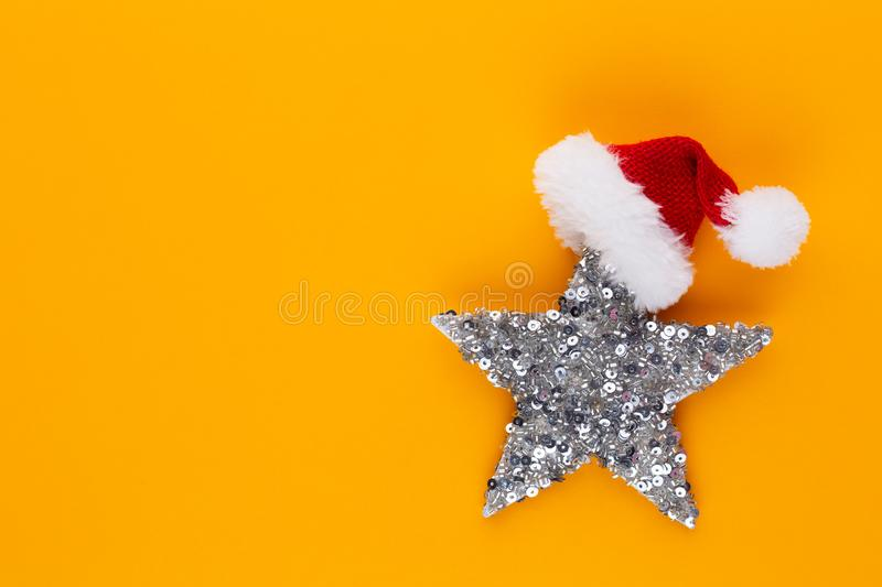 Christmas star, decor on pastel colored background. Christmas or New Year minimal concept.  stock image