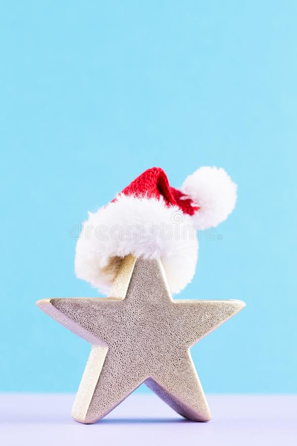 Christmas star, decor on pastel colored background. Christmas or New Year minimal concept.  royalty free stock image