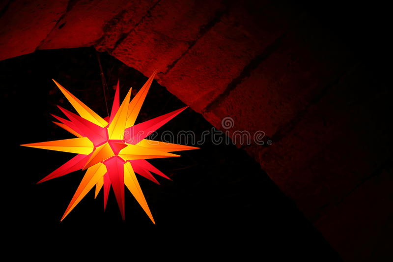 Christmas star at night. And lit stock photography