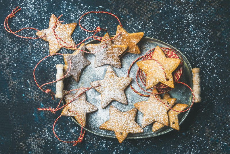 Christmas star shaped gingerbread cookies for tree decoration with ropes. Christmas holiday star shaped gingerbread cookies for Christmas tree decoration with stock photography
