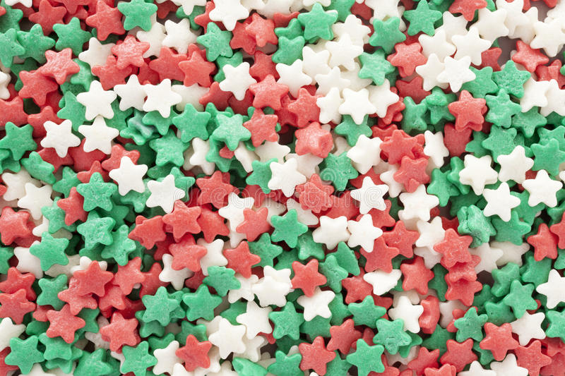 Christmas star shaped sprinkles background. stock photo