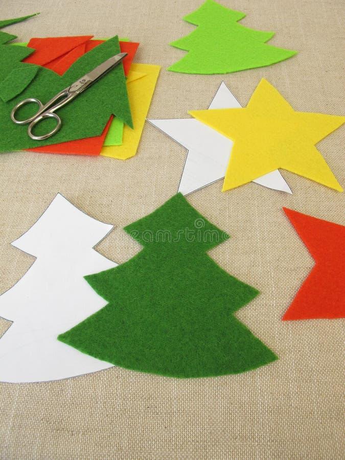 Christmas stars and christmas trees made of felt stock photography