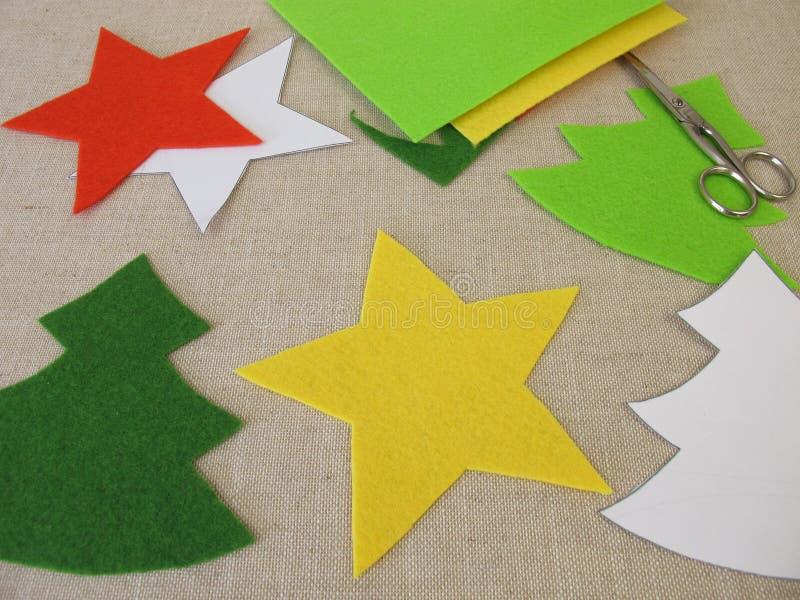 Christmas stars and christmas trees made of felt royalty free stock photos