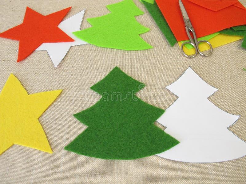 Christmas stars and christmas trees made of felt stock photo