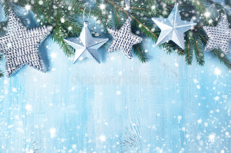 Christmas stars on wooden background with fir tree branches stock images