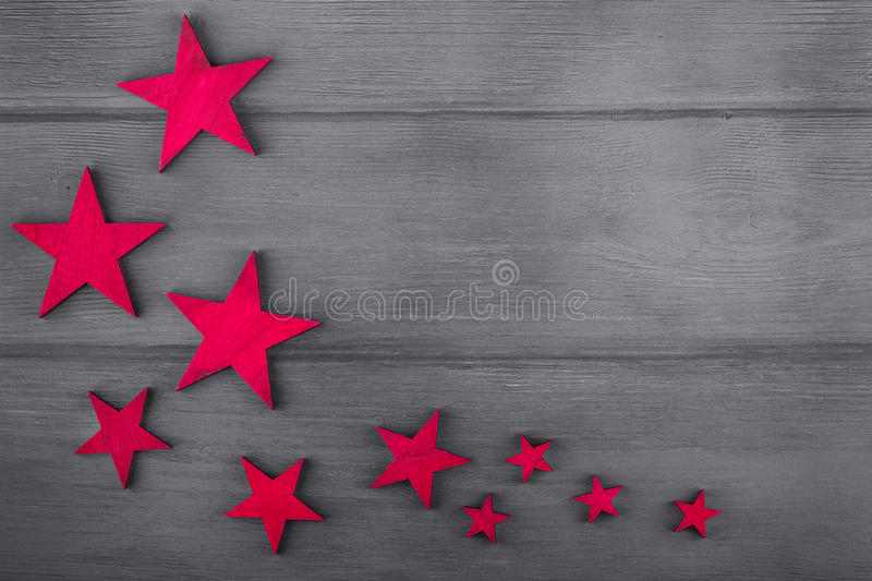 Christmas stars on wooden background. Top view. copy space. Christmas stars on wooden background. Top view with copy space stock photo
