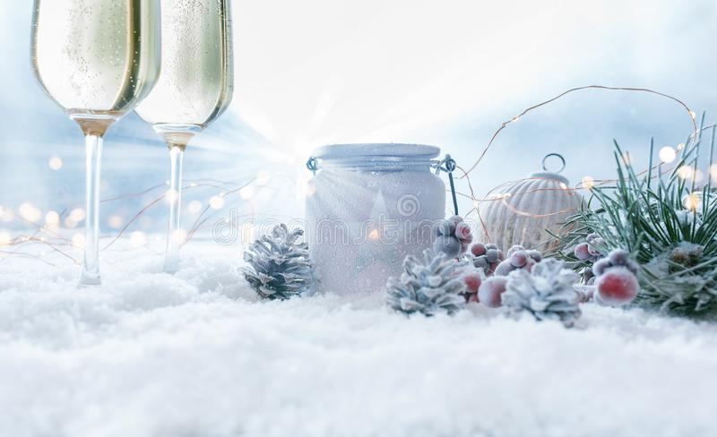 Christmas still life with champage in snow stock photos
