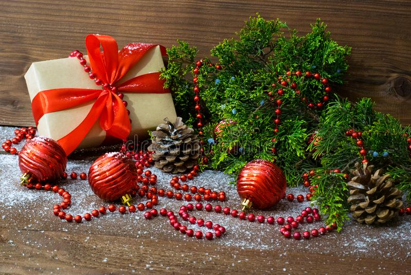 Christmas still life with gift box and fir tree branch and holiday toys royalty free stock photo