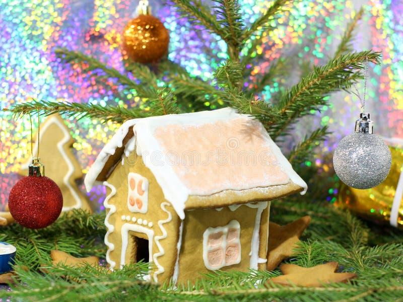 Christmas still life - gingerbread house, Christmas tree and Christmas balls royalty free stock image