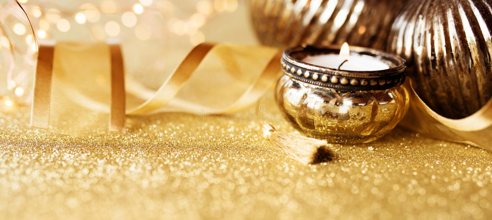 Christmas still life on gold sparkling background royalty free stock images