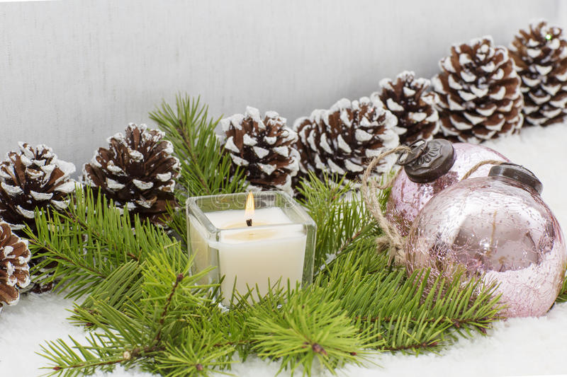 Christmas still life has the burning candle. stock photography