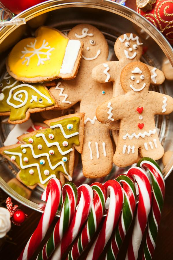 Christmas still life. homemade ginger biscuits, cane candy, on a wooden background. royalty free stock photo