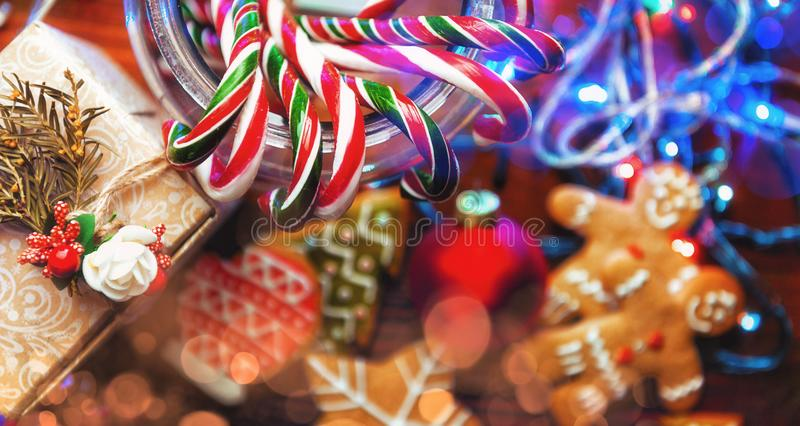 Christmas still life. homemade ginger biscuits, cane candy, on a. Wooden background stock photography