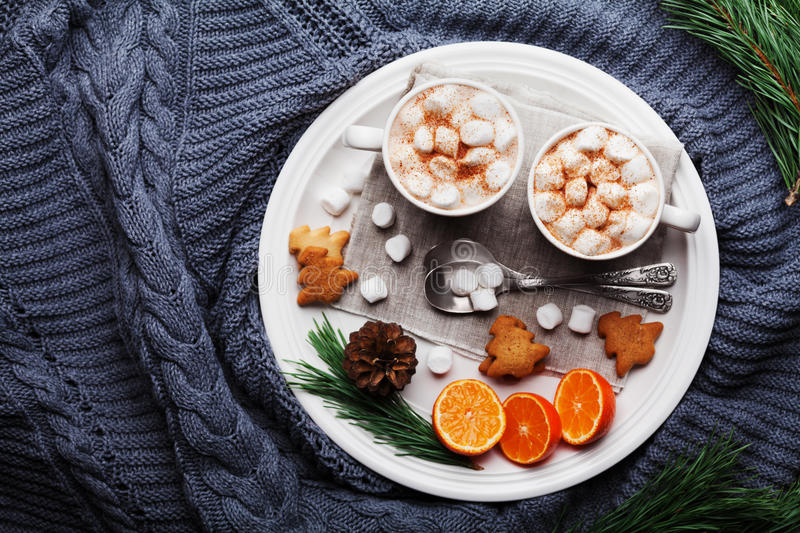 Christmas still life with hot cocoa, tangerines and cookies on knitted background above. Dessert for winter breakfast. Flat lay. stock photo