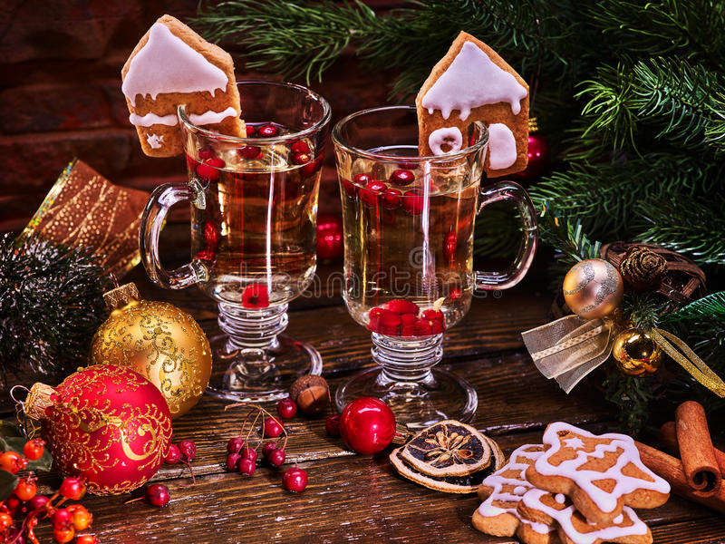 Christmas still life with pair mug hot drink. Warming mulled wine with cookie in form of house and Christmas ball on spruce branch royalty free stock images