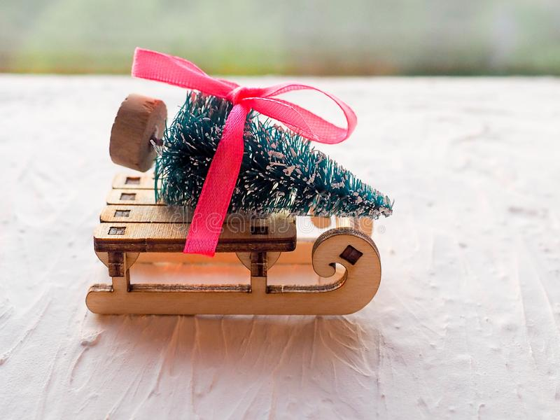 Christmas still life of a toy sled, Vintage photo, Gifts for Christmas on wooden sled, Merry Christmas tree transporter. Bringing gifts to all the sweethearts stock photo