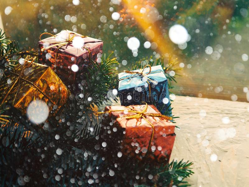 Christmas still life of a toy sled, Vintage photo, Gifts for Christmas on wooden sled, Merry Christmas tree transporter. Bringing gifts to all the sweethearts royalty free stock photography
