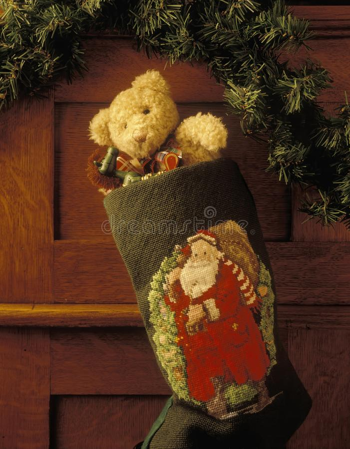 Christmas stocking with a bear and toy rocking horse royalty free stock image