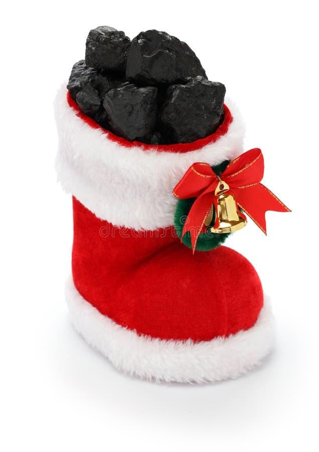 Christmas stocking full of coal royalty free stock image