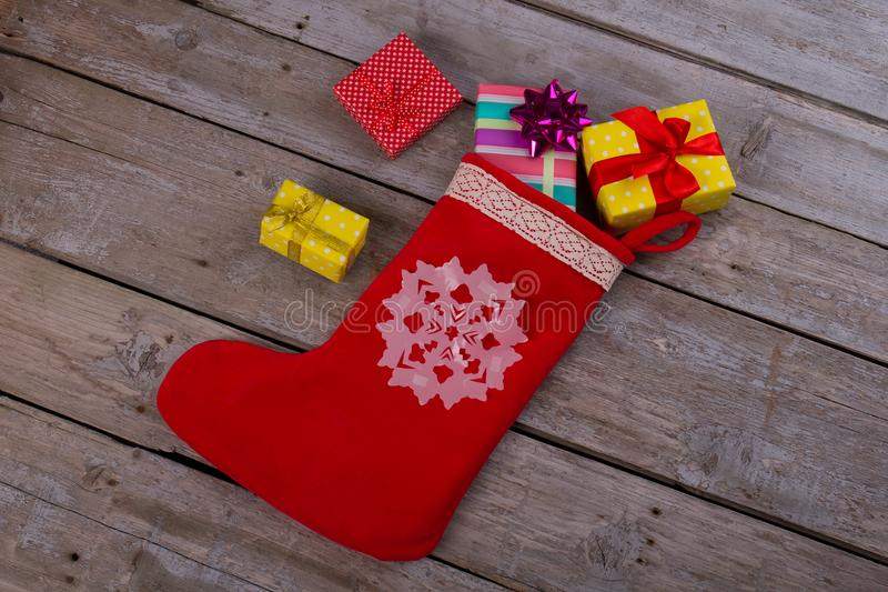 Christmas stocking and gift boxes royalty free stock photography